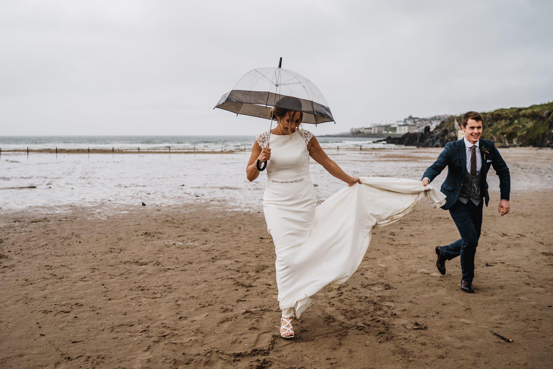 portstewart beach rain wedding couple