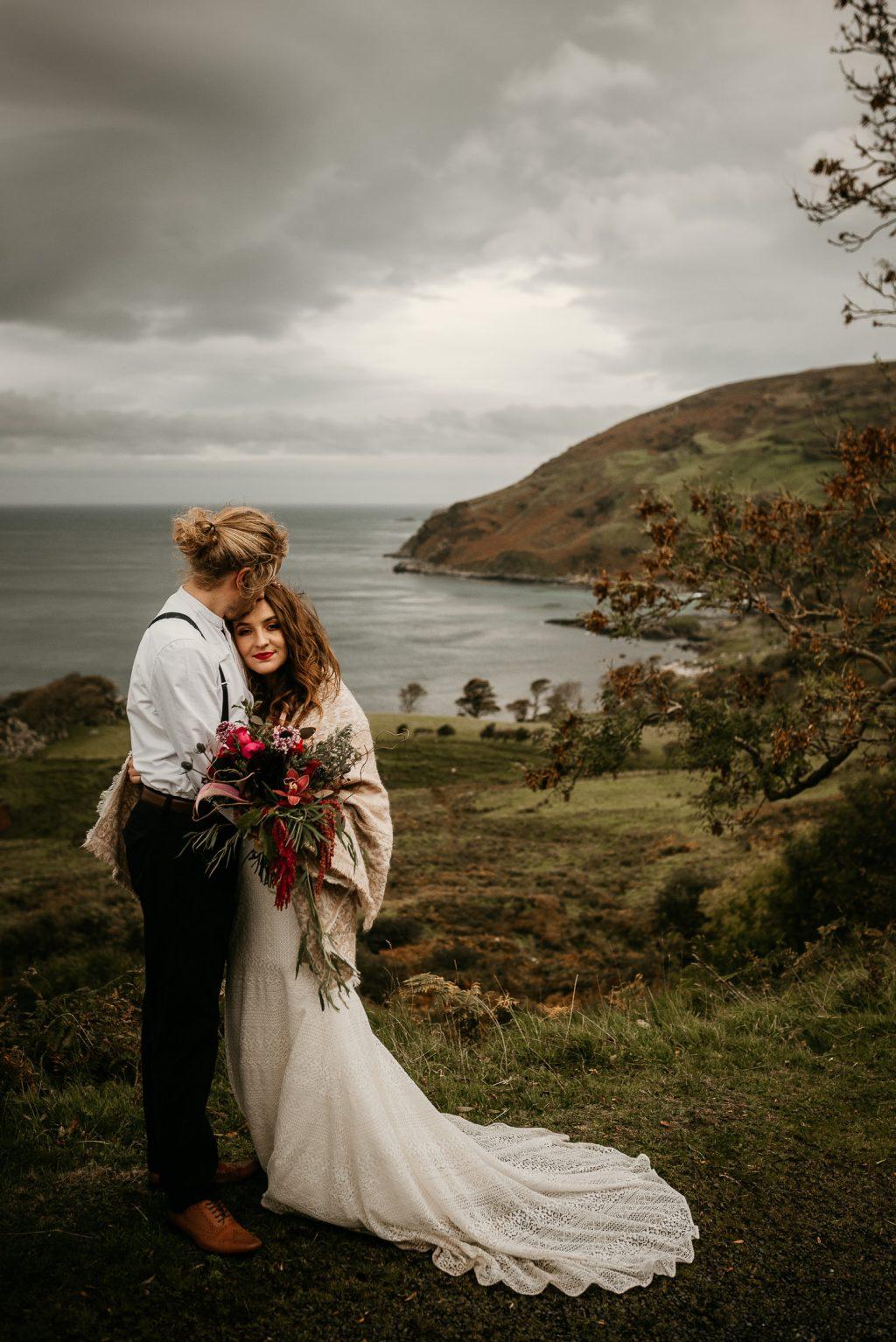 bride and groom overlooking murlough bay